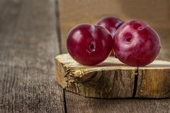 Plums on a wooden surface Royalty Free Stock Photos