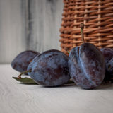 Plums for you. Plums near the basket in daylight stock photo