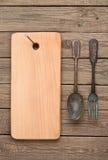 Plundrat bräde och gamla gafflar Arkivbilder