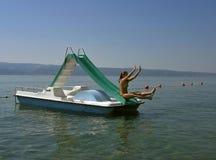 Plung im Meer (Pedalboot) Stockfotografie