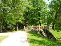 Plunge park, Lithuania. Footbridge, path and beautiful trees in Plunge town park, Lithuania stock image