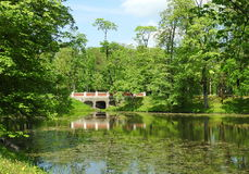 Plunge park, Lithuania. Little lake , footbridge and beautiful trees in Plunge town park, Lithuania stock image