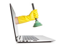 Plunger in hand the man out of the monitor. Royalty Free Stock Image