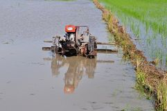 Pluogh machine in the paddy field Royalty Free Stock Images
