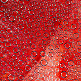 Plurality of air bubbles on a red background Stock Photo