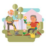 50 plus - couple gardening together. 50 plus couple gardening together in their backyard garden and spending time together outdoor Royalty Free Stock Photo