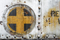 Plus cross add old metal background texture. Plus cross add sign symbol background texture from an old metal train car Stock Photography