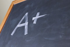Plus grade on chalkboard Stock Photo