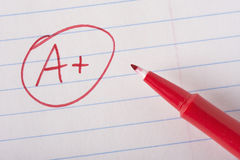 A plus grade with pen Stock Image
