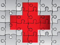 Plus medical sign on puzzle background Stock Photos