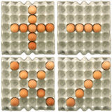 Plus-Minus-Multiply-Divide symbol s show by eggs. In paper tray Stock Photos