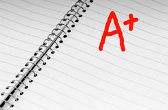 A Plus in Open notebook stock photography