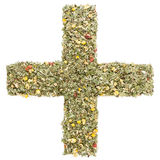 Plus sign made of herbs and tea leaves. A plus sign or a cross carefully arranged by hand from herbs and tea leaves, which can be perfectly used together with my Stock Image
