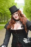 Plus size with black top-hat Stock Photo