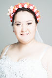 Plus size bride. With hairstyling and makeup studio shot Stock Image
