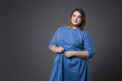 Plus size fashion model in casual clothes, fat woman on gray background, overweight female body Stock Images