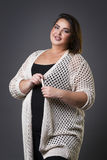 Plus size fashion model in casual clothes, fat woman on gray background, overweight female body. Plus size fashion model in casual clothes, fat woman on gray Royalty Free Stock Images