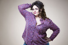 Plus size fashion model in casual clothes, fat woman on studio background, overweight female body. Plus size fashion model in casual clothes, fat woman on beige stock photo