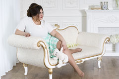 Plus size fashion model, fat woman on luxury interior, overweight female body Royalty Free Stock Photography