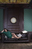 Plus size fashion model in green evening dress, fat woman on luxury interior, overweight female body Stock Photos
