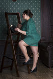 Plus size fashion model in green evening dress, fat woman on luxury interior, overweight female body Stock Image
