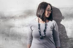 Plus size fashion model over gray street wall Stock Photography