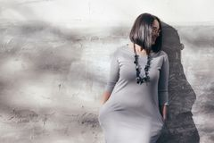 Plus size fashion model over gray street wall Royalty Free Stock Image