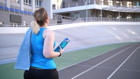 Plus size female walking along track after running