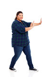Plus size girl. Pretty plus size teenage girl pushing on empty copyspace royalty free stock photos