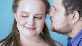 Plus size man talking compliment to beautiful shy girlfriend, happiness, date. Stock footage stock video