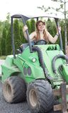 Plus size model  black bra xxl woman Young beautiful busty curv. Beautiful girl plus size manages a tractor in a garden nursery Stock Photos