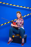 Plus-size model on a blue background with the construction of th Royalty Free Stock Image