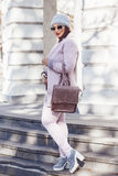 Plus size model in pink coat Royalty Free Stock Images