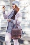 Plus size model in pink coat Stock Photo