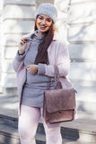 Plus size model in pink coat Stock Photography