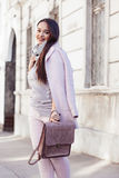 Plus size model in pink coat Stock Images