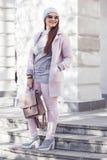 Plus size model in pink coat Stock Photos