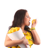 Plus size model posing like fashion models with lime Royalty Free Stock Images