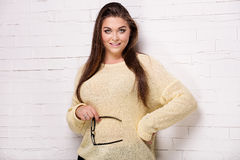 Plus size model posing in studio. Royalty Free Stock Photography