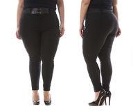 Plus size model wear XXL black female classic pants with leather belt and high heels  on white Royalty Free Stock Photos