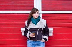 Plus size model in winter look with coffee royalty free stock photography