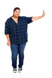 Plus size woman. Full length of beautiful plus size woman pushing on empty copyspace royalty free stock images