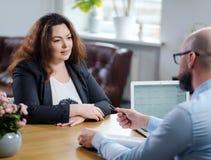 Plus size woman attending job interview. Plus size women attending job interview stock photography