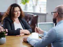 Plus size woman attending job interview. Plus size women attending job interview stock images