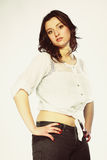 Plus size woman in casual clothes posing in studio Royalty Free Stock Image