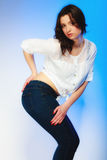 Plus size woman in casual clothes posing in studio Royalty Free Stock Photos