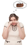 Plus size woman crying about cake stock photography
