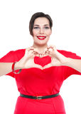 Plus size woman doing heart shape with hands. Focus on hands Stock Images