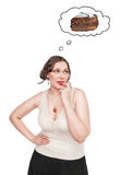 Plus size woman dreaming about cake Royalty Free Stock Photo