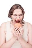 Plus size woman eating hamburger. Beautiful plus size woman eating hamburger isolated Royalty Free Stock Image